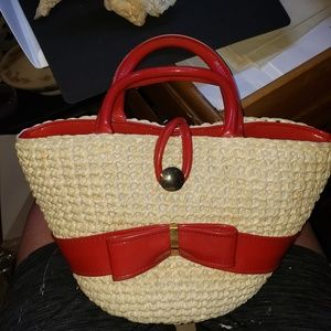 Straw purse red leather(?)trim w/candle foreign